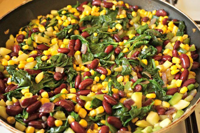 Veggies beans and corn mixed for vegetarian enchiladas