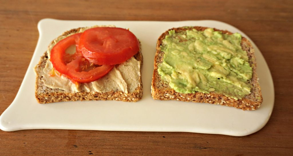 Making Avocado-Tomato-Hummus Sandwich