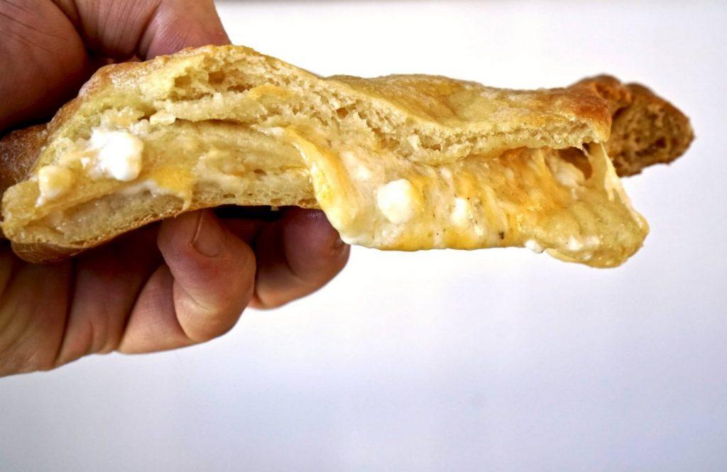 Khachapuri - Wedge in hand - Tasting Georgia